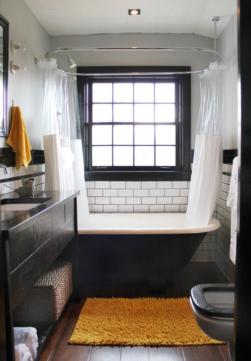 A Traditional Black And White Bath With One Little Splash Of Orange